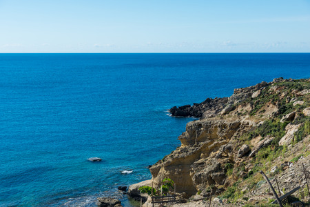 Rocky coast of Rhodes island in sunny day. Mediterranean coast in Greece. 免版税图像