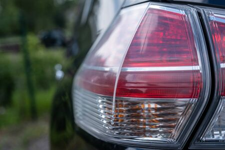 the close-up large rear lights of black cars Reklamní fotografie