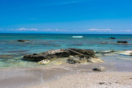 Seashore with rocks on the island of Rhodes in the Mediterranean sea in summer day.