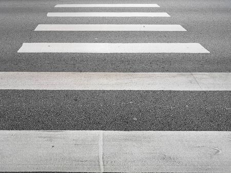 The crosswalk is there for people to walk across the road safely. Zebra at the pedestrian crossing.