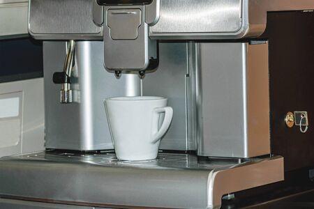 Automatic espresso machine for making coffee on a mug in a bar, restaurant.