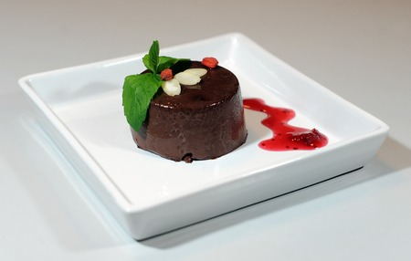 plum pudding: Chocolate pudding with goia and almond Stock Photo