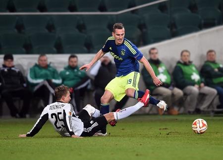 ajax: Warsaw, Poland - February 26, 2015 : UEFA Europa League play off stage Legia Warsaw Ajax Amsterdam Jakub Rzezniczak Arkadiusz MIlik