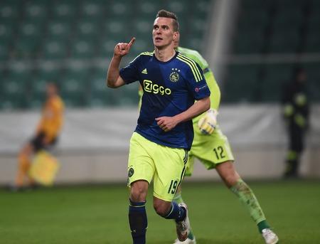 ajax: Warsaw, Poland - February 26, 2015 : UEFA Europa League play off stage Legia Warsaw Ajax Amsterdam Arkadiusz Milik
