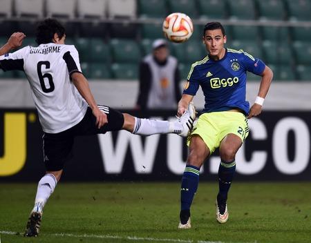 ajax: Warsaw, Poland - February 26, 2015 : UEFA Europa League play off stage Legia Warsaw Ajax Amsterdam Guilherme Anwar El Ghazi Editorial