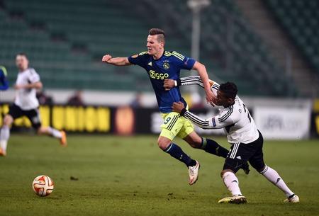 uefa: Warsaw, Poland - February 26, 2015 : UEFA Europa League play off stage Legia Warsaw Ajax Amsterdam Arkadiusz Milik Dossa Junior Editorial
