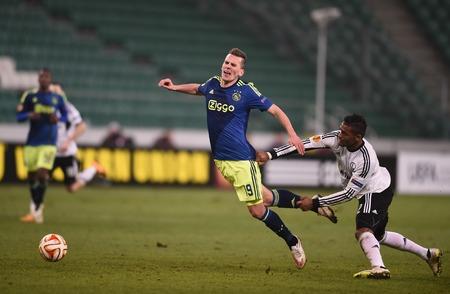 ajax: Warsaw, Poland - February 26, 2015 : UEFA Europa League play off stage Legia Warsaw Ajax Amsterdam Arkadiusz Milik Dossa Junior Editorial