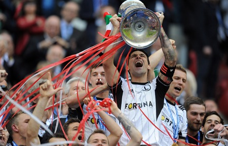 teammates: WARSAW, POLAND - MAY 02, 2015: Polish Football League Cup Final Legia Warsaw - Lech Poznan op: Michal Zyro, Tomasz Jodlowiec, Ivica Vrdoljak with the cup
