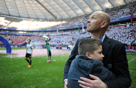 teammates: WARSAW, POLAND - MAY 02, 2015: Polish Football League Cup Final Legia Warsaw - Lech Poznan op: Henning Berg with son