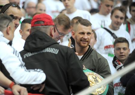 ultras: WARSAW, POLAND - MAY 02, 2015: Polish Football League Cup Final Legia Warsaw - Lech Poznanop: Andrzej Fonfara IBO Light Heavyweight World Boxing Champion