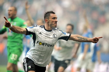 ultras: WARSAW, POLAND - MAY 02, 2015: Polish Football League Cup Final Legia Warsaw - Lech Poznanop: Marek Saganowski scores celebrate goal