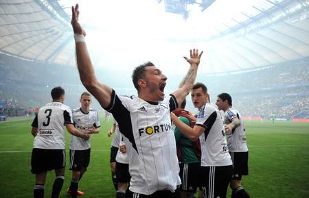 ultras: WARSAW, POLAND - MAY 02, 2015: Polish Football League Cup Final Legia Warsaw - Lech Poznanop: Marek Saganowski goal scores celebrate, Michal Zyro, Ondrej Duda
