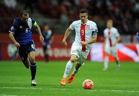 WARSAW, POLAND - SEPTEMBER 07, 2015: EURO 2016 France Football Euro Cup Qualifiers Poland vs Gibraltarop Roy Chipolina Robert Lewandowski Редакционное