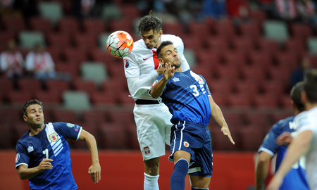 qualify: WARSAW, POLAND - SEPTEMBER 07, 2015: EURO 2016 France Football Euro Cup Qualifiers Poland vs Lukasz Gibraltarop was looking for Joseph Chipolina Editorial