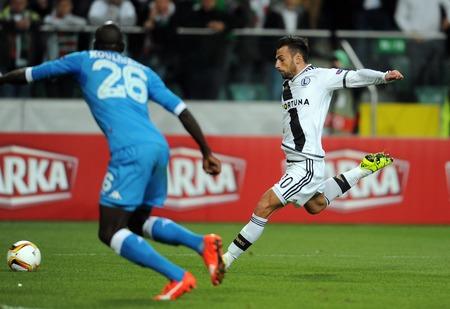 midfielder: WARSAW, POLAND - OCTOBER 1, 2015: UEFA Europa League group stage Legia Warsaw SSC Napoliop: kalidou koulibaly Napoli Ivan Trickovski Editorial