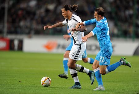 uefa: WARSAW, POLAND - OCTOBER 1, 2015: UEFA Europa League group stage Legia Warsaw SSC Napoliop Aleksandar Prijovic Vlad Chiriches Napoli Editorial