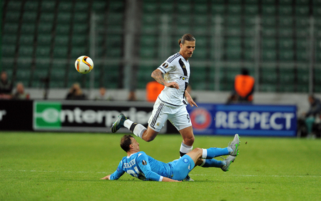 midfielder: WARSAW, POLAND - OCTOBER 1, 2015: UEFA Europa League group stage Legia Warsaw SSC Napoliop Vlad Chiriches Napoli Aleksandar Prijovic