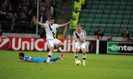 midfielder: WARSAW, POLAND - OCTOBER 1, 2015: UEFA Europa League group stage Legia Warsaw SSC Napoliop Vlad Chiriches Napoli Thomas Jodlowiec Igor Lewczuk