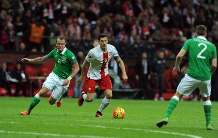 glenn: WARSAW, POLAND - OCTOBER 11, 2015: EURO 2016 European Championship Round Qualifing France Poland - Republic of Irelandop Glenn Whelan Robert Lewandowski