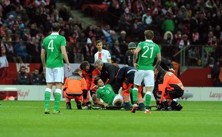 european championship: WARSAW, POLAND - OCTOBER 11, 2015: EURO 2016 European Championship Round Qualifing France Poland - Republic of Irelandop Shane Long injury