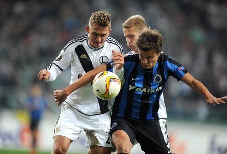 uefa: WARSAW, POLAND - OCTOBER 22, 2015: UEFA Europa League group stage Legia Warsaw Club Brugge Belgiumop: James Rzezniczak Jelle Vossen