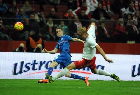 european championship: WARSAW, POLAND - NOVEMBER 13, 2015: EURO 2016 European Championship Friendly game Poland - Icelandop Birkir Mar Savarsson Kamil Glik