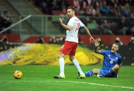 european championship: WARSAW, POLAND - NOVEMBER 13, 2015: EURO 2016 European Championship Friendly game Poland - Icelandop Jakub Wawrzyniak Ragnar Sigurdsson