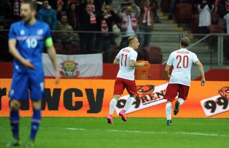 european championship: WARSAW, POLAND - NOVEMBER 13, 2015: EURO 2016 European Championship Friendly game Poland - Kamil Grosicki goal Icelandop