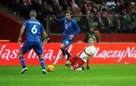european championship: WARSAW, POLAND - NOVEMBER 13, 2015: EURO 2016 European Championship Friendly game Poland - Icelandop Theodor Elmar Bjarnason Lukasz Piszczek