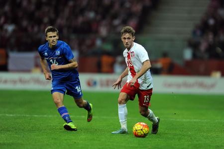 european championship: WARSAW, POLAND - NOVEMBER 13, 2015: EURO 2016 European Championship Friendly game Poland - Icelandop Arnor Ingvi Traustason Maciej Rybus