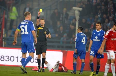 ruch: CRACOV, POLAND - OCTOBER 30, 2015: T-Mobile Extra League Polish Premier Football League Wisla Krakow - Ruch Chorzow op: refree yellow card Rafal Grodzicki Editorial
