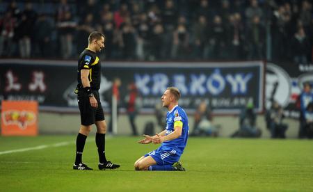 ruch: CRACOV, POLAND - OCTOBER 30, 2015: T-Mobile Extra League Polish Premier Football League Wisla Krakow - Ruch Chorzow op: refree Rafal Grodzicki Editorial