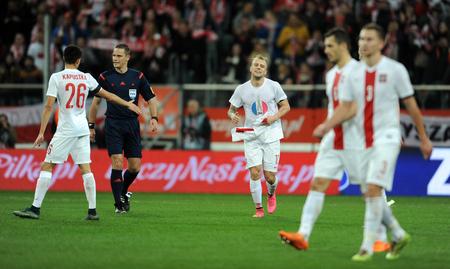 european championship: WROCLAW, POLAND - NOVEMBER 17, 2015: EURO 2016 European Championship friendly game Poland - Czech Republic op Kamil Grosicki goal solidarity with Paris