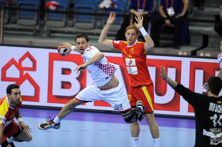 igor: CRACOV, POLAND - JANUARY 21, 2016: Mens EHF European Handball Federation EURO 2016 Krakow Tauron Arena Macedonia - Croatia op: Igor Karacic Goce Georgievski