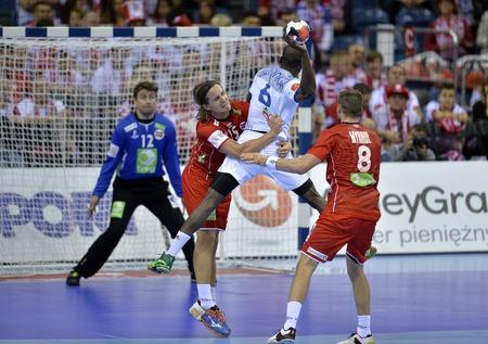 CRACOV, POLAND - JANUARY 27, 2016: Men's EHF European Handball Federation EURO 2016 Krakow Tauron Arena France Norwayo/p: Robin Kend Tonnesen Olivier Guy Nyokas