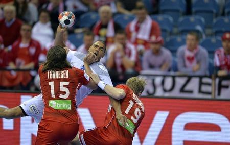 CRACOV, POLAND - JANUARY 27, 2016: Men's EHF European Handball Federation EURO 2016 Krakow Tauron Arena France Norwayo/p: Robin Kend Tonnesen Daniel Narcisse Kristian Bjornsen
