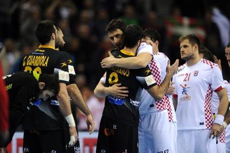 igor: CRACOV, POLAND - JANUARY 29, 2016: Mens EHF European Handball Federation EURO 2016 Krakow Tauron Arena Spain Croatia op: Raul Entrerrios Igor Karacic Editorial