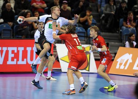 CRACOV, POLAND - JANUARY 29, 2016: Men's EHF European Handball Federation EURO 2016 Krakow Tauron Arena Germany Norwayo/p: Julius Kuhn Robin Kend Tonnesen Sajtókép