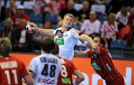Cracov, POLAND - JANUARY 29, 2016: Men's EHF European Handball Federation EURO 2016 Krakow Tauron Arena Germany Norwayop: Julius Kuhn Robin Kend Tonnesen
