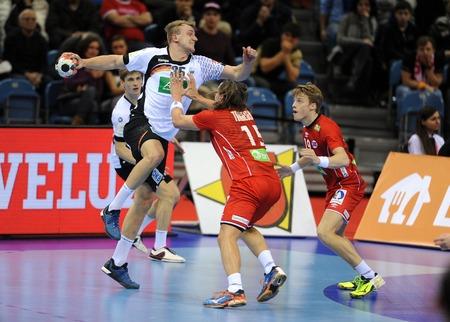 Cracov, POLAND - JANUARY 29, 2016: Men's EHF European Handball Federation EURO 2016 Krakow Tauron Arena Germany Norwayop: Julius Kuhn Robin Kend Tonnesen Sajtókép