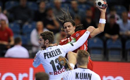 Cracov, POLAND - JANUARY 29, 2016: Men's EHF European Handball Federation EURO 2016 Krakow Tauron Arena Germany Norwayop: Hendrik Pekeler Robin Kend Tonnesen