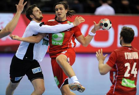 Cracov, POLAND - JANUARY 29, 2016: Men's EHF European Handball Federation EURO 2016 Krakow Tauron Arena Germany Norwayop: Hendrik Pekeler Robin Kend Tonnesen Sajtókép