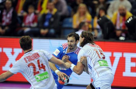 Cracov, POLAND - JANUARY 29, 2016: Men's EHF European Handball Federation EURO 2016 Krakow Tauron Arena Norway op Croatia: Igor Karacic Robin Kend Tonnesen Sajtókép