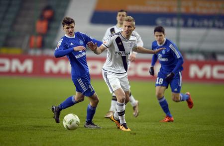 igor: WARSAW, POLAND - FEBRUARY 28, 2016, T-Mobile Polish Extra League Premier Football League Legia Warsaw movement Chorzowop: Patryk Lipski Igor Lewczuk