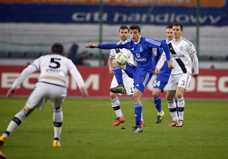 midfielder: WARSAW, POLAND - FEBRUARY 28, 2016, T-Mobile Polish Extra League Premier Football League Legia Warsaw movement Chorzowop: Patryk Lipski Editorial