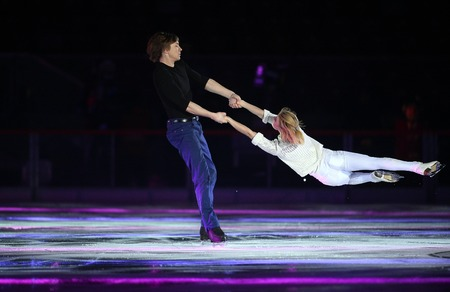konstantin: WARSAW, POLAND - FEBRUARY 27, 2016: Kings on Ice figure skating show jump made by Evgeni Plushenko and life music by Edvin Marton Emmy award winner world famous violinist playing with 300 year old Anastasia Stradivariusnz Martyuseva Konstantin Gavrin