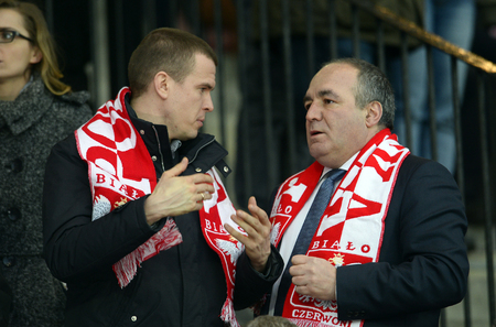 shove: WARSAW, POLAND, MARCH 19, 2016: Inernational rugby game Poland - Belgium Europe Rugby Cupo  p Witold Banka minister of sport in Poland on the left