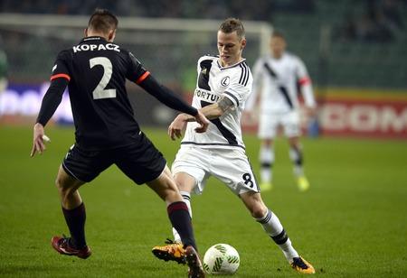 midfielder: WARSAW, POLAND - MARCH 05, 2016, T-Mobile Polish Extra League Premier Football League Legia Warsaw Gornik Zabrzeo  p: Bartosz Kopacz Ondrej Duda Editorial