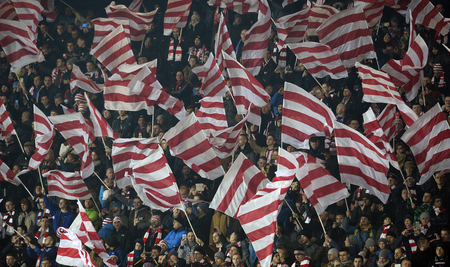 fan: Cracov, POLAND - MARCH 12, 2016, T-Mobile Polish Extra League Premier Football League Cracovia Legia Cracov Warsawo  p: Cracovia fans supporters