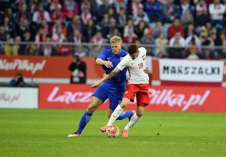 paulus: WROCLAW, POLAND, MARCH 26, 2016: Inernational Friendly football game Poland - Finlando  p Paulus Arajuuri (Lech Poznan) Pawe? Wszo?ek